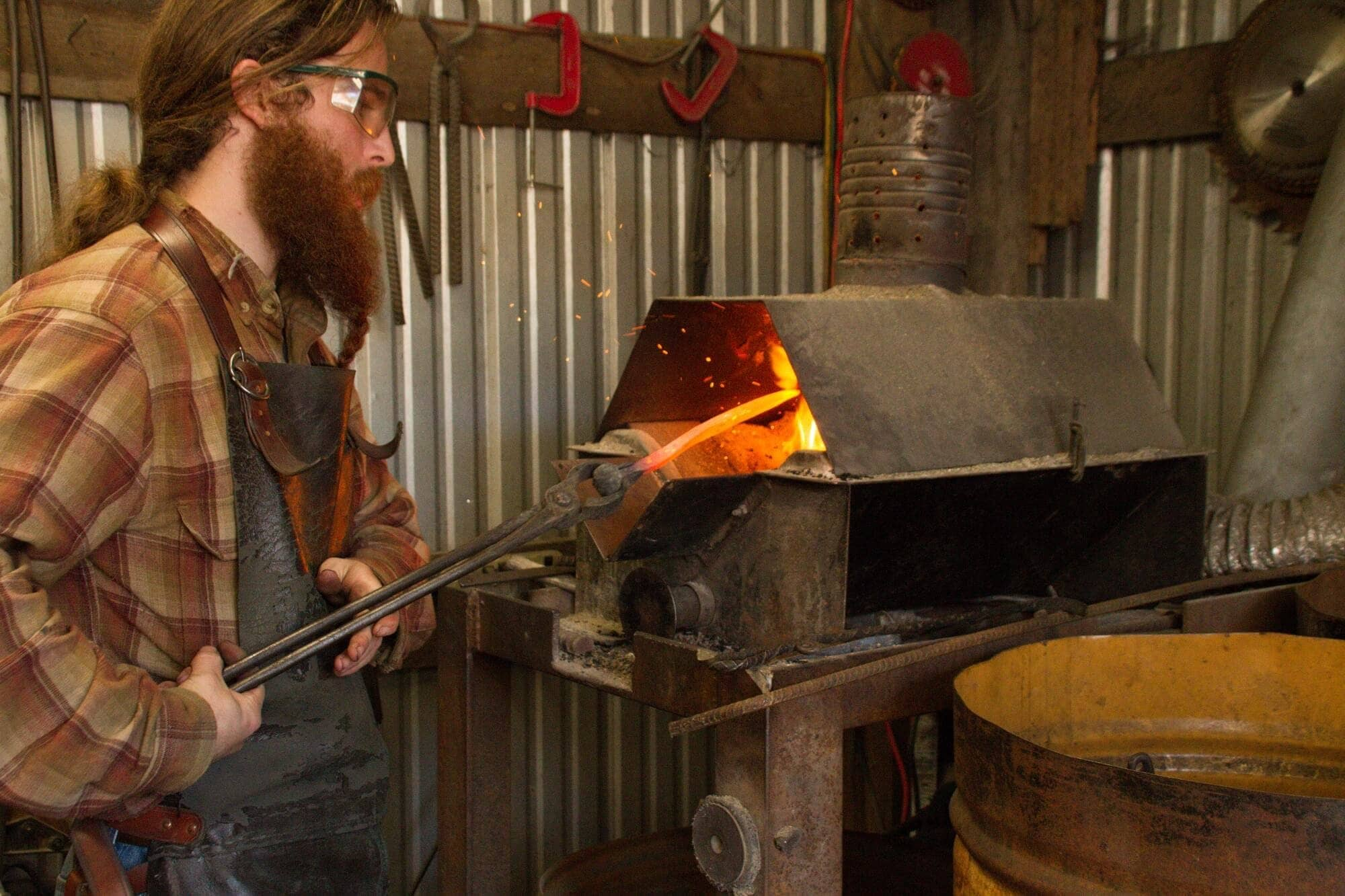 https://www.kawanti.com/wp-content/uploads/2018/11/ARS-blacksmith-working.jpg